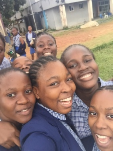 Queens' College Students pose for a selfie after a training session, July 2019